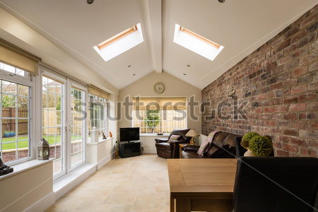 stock-photo-sun-room-modern-sunroom-or-conservatory-extending-into-the-garden-with-a-featured-brick-wall-266169320